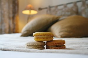 Macaroons on bed in hotel